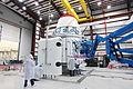 Dragon solar array fairing installation in SLC-40 hangar - CRS-2 (KSC-2013-1110).jpg