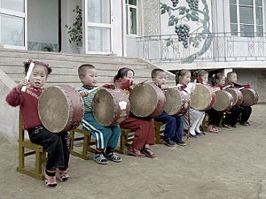 Music of North Korea - North Korean children performing for tourists at Chonsam Cooperative Farm near Wonsan