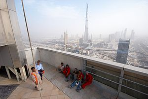 English: Dubai construction workers having the...