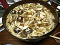 Duck meat and mushrooms in a hot pot (5259576145).jpg