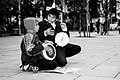Dy femije Rom ne sheshin e Prishtines duke kerkuar lemoshe.jpg