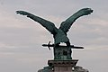 Eagle carrying sword (15916053167).jpg