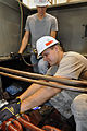 Electricians at Wolf Creek Power Plant complete fix on a differential (10019459743).jpg