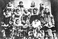 Eleven young white men wearing fur parkas, Nome, Alaska, between 1905 and 1915 (AL+CA 6473).jpg