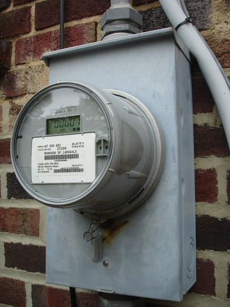 "Smart meter - Newer retrofitted U.S. domestic digital electricity meter Elster REX with 900MHz mesh network topology for automatic meter reading and ""EnergyAxis"" time-of-use metering."