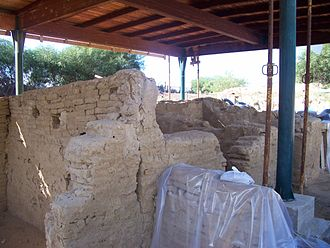 Bosco Littorio - Excavation of the ancient emporium: traces of the holes for roof beams are visible.