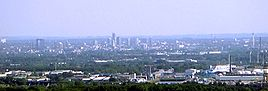 "View over the centre of Essen from the ""Tetraeder"" landmark in Bottrop. In the background the Ruhr Heights."