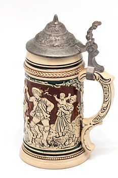 Faience beer stein with ball scene on brown background 01.jpg