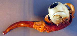 Smoking - An elaborately decorated pipe