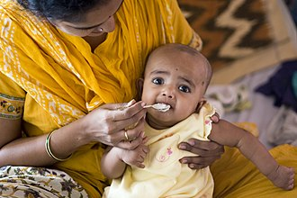 Baby food - A Hindu child receives its first solid food in a religious ceremony called Annaprashana