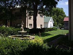 Peabody, Kansas - Fountain next to W.H. Morgan House (immediate right), W.H. Morgan Barn (back right with red roof), Carnegie Library (left with brown brick), Museum (back middle with green roof). Looking north-east (2010)