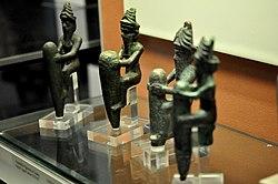 Four statuettes of Mesopotamian gods.jpg