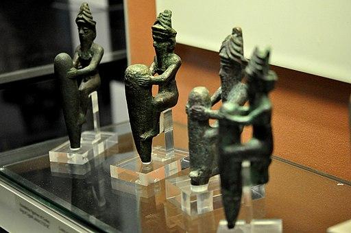 Four statuettes of Mesopotamian gods