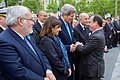 French President Hollande Greets Secretary Kerry After 70th Anniversary VE Day Commemoration in Paris (16804164903).jpg