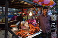 Fried shrimp head seller - outside Bijoy mela - Chittagong.jpg
