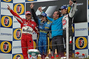 2005 San Marino Grand Prix - Fernando Alonso, Michael Schumacher and Jenson Button celebrate on the podium. Button was later disqualified from the race along with BAR team-mate Takuma Sato.