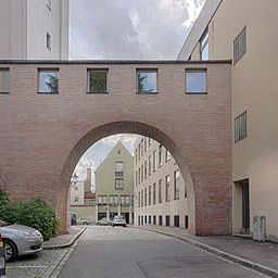 Gate with hallway bridging ymnasium and church of St. Stephan