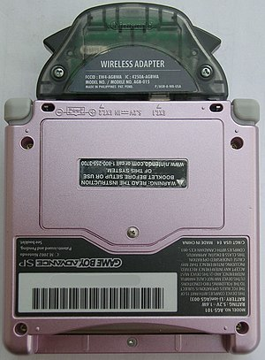 Game Boy Advance Wireless Adapter - A Pearl Pink Game Boy Advance SP with the wireless adapter attached