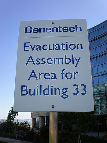 An evacuation assembly area sign for Building ...