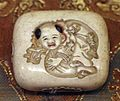 Giappone, periodo edo, netsuke (fermaglio per inroo), xix secolo, 106 uomo cinese con sacco.jpg