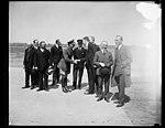 Group at field; Frank Kellogg at left, Charles Lindbergh third from right LCCN2016888773.jpg