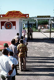 In 1983, Cuban workers return home through the North East Gate.