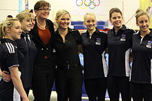 A group shot of the 2012 Australian Olympic gymnastics team, showing Emily Little, Lauren Mitchell, Peggy Liddick, Kate Lundy, Larrissa Miller, Georgia Bonora and Ashleigh Brennan.