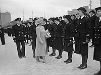 HM Queen Elizabeth inspecting a detachment of Wrens on the quayside at Belfast, 1942. A10043.jpg