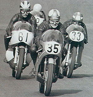 Mike Hailwood - Hailwood 35 leading from the start of a 250 race at Cadwell Park with Phil Read on Yamaha number 61 closely followed by Rod Gould Bultaco 33, around 1967