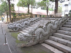 Hanoi Citadel - Carved stone dragons flanking the stairs to the destroyed Kính Thiên Palace