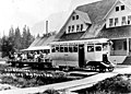 Hartford Eastern Railway car with tourists in front of Big Four Inn, near Monte Cristo, Snohomish County, Washington, ca 1923 (WASTATE 410).jpeg