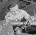 Heart Mountain Relocation Center, Heart Mountain, Wyoming. A young Nisei machinist reparing a truck . . . - NARA - 539253.tif
