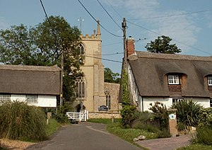 Elsworth - Image: Holy Trinity church and thatched cottages in Elsworth geograph.org.uk 462193