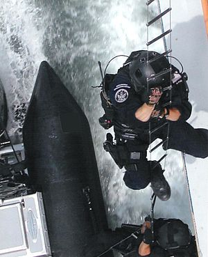 United States Coast Guard - Members of the Coast Guard Maritime Security Response Team (MSRT) hook and climb onto a target