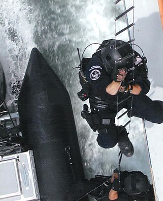 United States Coast Guard - Members of the U.S. Coast Guard Maritime Security Response Team (MSRT) hook and climb onto a target showing the skills needed to complete a variety of missions dealing with anti-terrorism, protecting local maritime assets, and harbor and inshore security patrols as well as detecting, stopping, and arresting submerged divers, using the Underwater Port Security System.