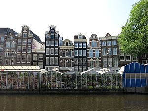 Singel - Stalls of the Bloemenmarkt (flower market) floating in the Singel
