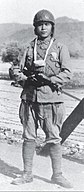 IJN paratrooper,carrying ashes of fallen comrade.jpg