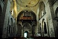 Interior of the Eglise Abbattiale St. Marie at Souillac, entrance under the tower with organ and relief - panoramio.jpg