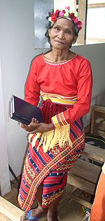 An Isnag woman wearing traditional attire, having just performed a traditional dance.