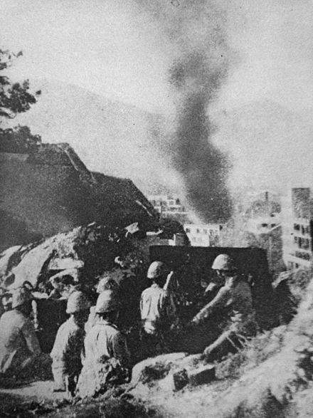 Japanese artillery firing at Hong Kong Japanese Artillery Firing at Hong Kong, WWII.JPG