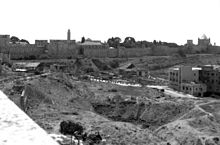 Largely empty land near the Old City wall, Dormition Abbey (on the far right), and Tower of David  (center-left).