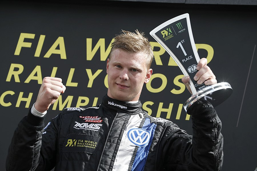 Swedish rallycross driver Johan Kirstoffersson celebrates first place at Round 6 of the 2014 FIA European Rallycross Championship, at Circuit Jules Tacheny Mettet, Belgium.