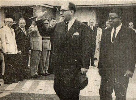 Kasa-Vubu with the outgoing Governor-General of the Congo, Hendrik Cornelis, before the latter's departure from the country, July 1960. Kasa-Vubu and Governor-General Cornelis.jpg