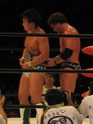 Chris Sabin - Sabin (right) fastening the World Junior Heavyweight Championship belt around the waist of Katsuhiko Nakajima, after Nakajima had defeated Sabin to retain it in August 2007