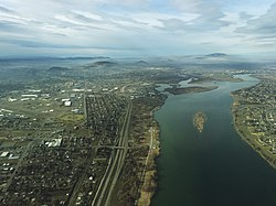 An aerial view of Kennewick taken from above the Columbia River near the Blue Bridge.