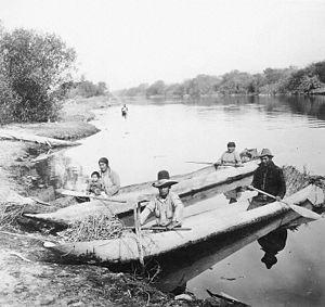Klamath people - Klamath people in dugout canoes, 19th century