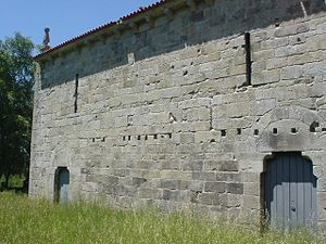 Church of Santo André (Melgaço) - The lateral facade (left), showing the holes that supported beams from the historical cloister