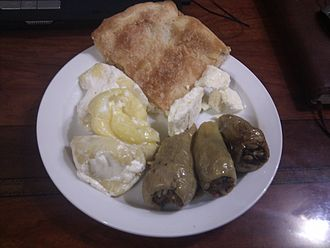 Kosovan cuisine - Sarma, peppers filled with kefir and cottage cheese, and pite.