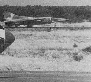 Faya-Largeau - LARAF MiG-23MS with empty missile rails rolling along the runway at Faya Largeau AB, some time in the mid-1980s. Also note the radome of an Il-76MD in the foreground left. Faya Largeau was the main Libyan base in northern Chad until the building of Ouadi Doum.