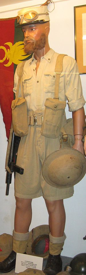 1937 Pattern Web Equipment - Uniform of the Légionnaires during the Battle of Bir Hakeim (1942). Note the 37 Pattern Webbing, Basic Pouches, and Sten submachine gun.